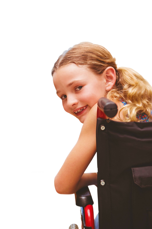 Portrait of cute girl sitting in wheelchair
