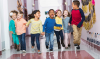 Multiracial-group-of-preschoolers-running-down-hallway-TRIMMED-2650x1569