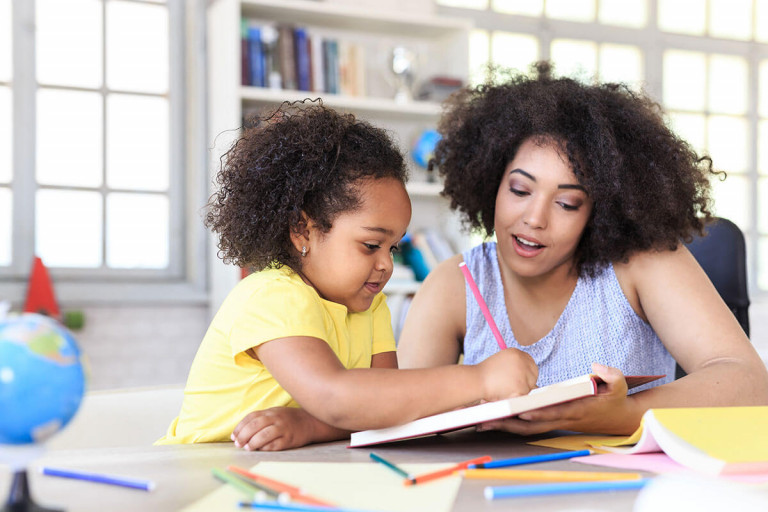 Mom,_daughter_school_at_home_iStock-819770674